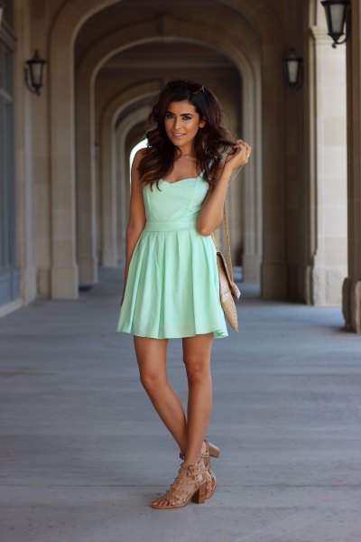 light green mini skater dress with a sweetheart neckline and strappy heels