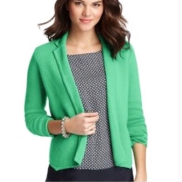 light green wool blazer with black and white printed blouse