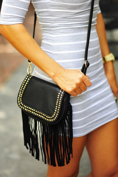 light gray and white striped mini dress with half sleeves and black leather shoulder bag