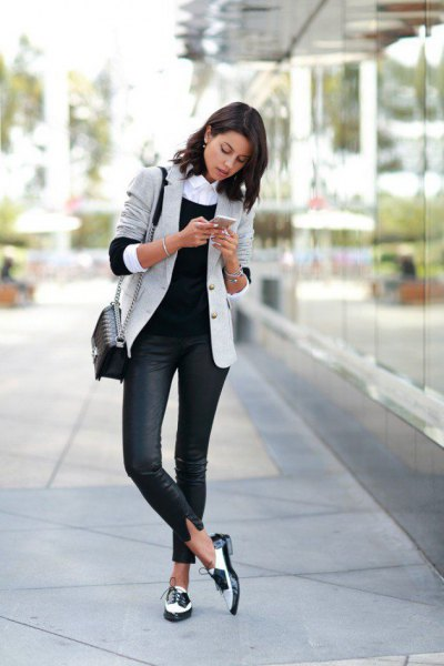 light gray blazer with dark blue skinny jeans and white goat shoes