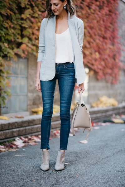 Light gray blazer with a white tank top with a scoop neckline and short jeans