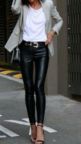 light gray blazer with white T-shirt and leather gaiters with belt