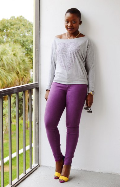 light gray long sleeve t-shirt with boat neckline and purple jeans