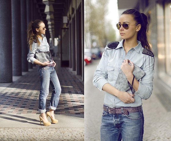 light gray shirt with buttons and baggy jeans with belt