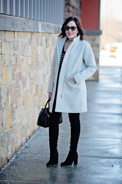 light gray cocoon coat with black and white striped tank top