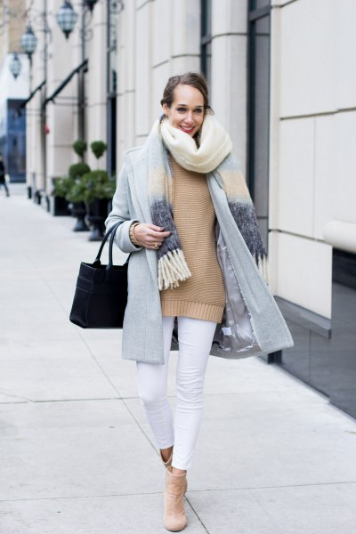 Light gray cocoon coat with a blushing pink sweater and white, cropped jeans