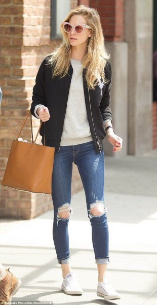 Light gray crew neck sweater, black leather aviator jacket and ripped jeans
