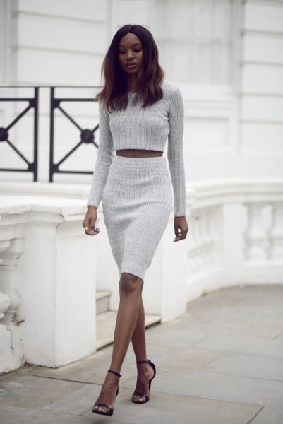 Light gray cropped sweater with matching high-waisted knee-length skirt