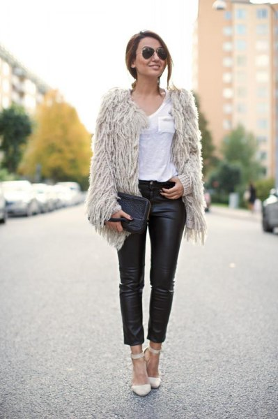 Light gray faux fur jacket with black, high-waisted leather gaiters