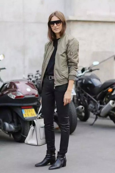light gray flight jacket with black leather gaiters