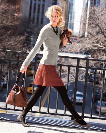 Light gray, figure-hugging cashmere sweater with red pleated mini skirt