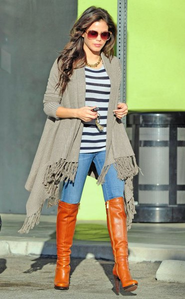 light gray knitted sweater with fringes and orange thigh high boots