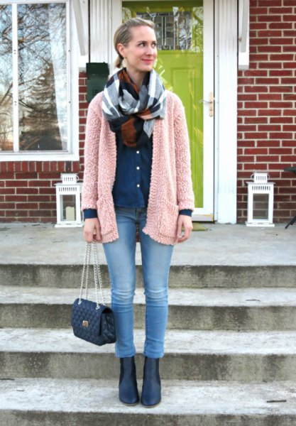 light gray fuzzy cardigan with blue jeans and leather boots