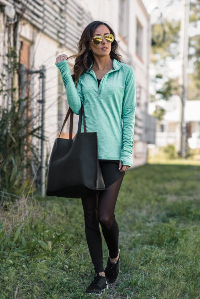 Light gray tunic sweater with half zip and black leggings
