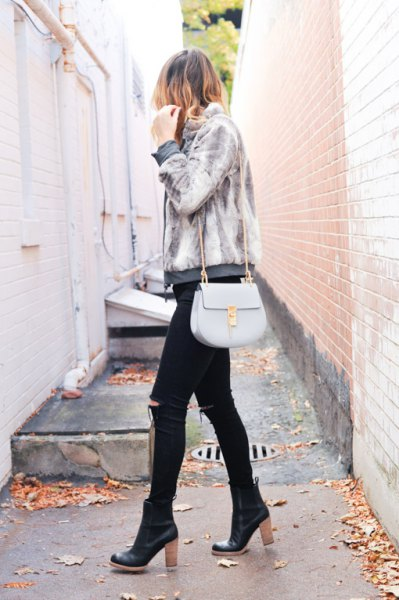 light gray jacket with black skinny jeans and black leather boots