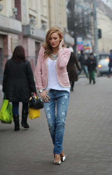 light gray jacket with white top with scoop neckline and ripped jeans