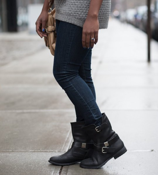 Light gray knitted sweater dress with dark skinny jeans and black leather ankle boots