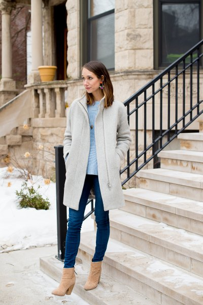 light gray long coat with sky blue sweater and skinny jeans