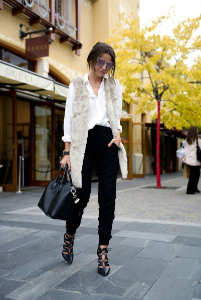 light gray long vest with white shirt and black high-rise chinos