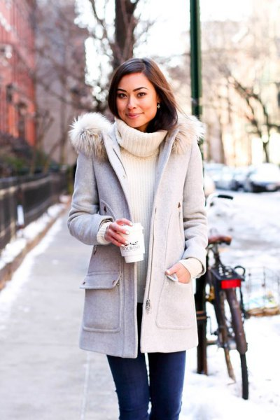 light gray long winter coat with white turtleneck sweater