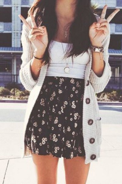 light gray longline cardigan with black and white printed minirater skirt