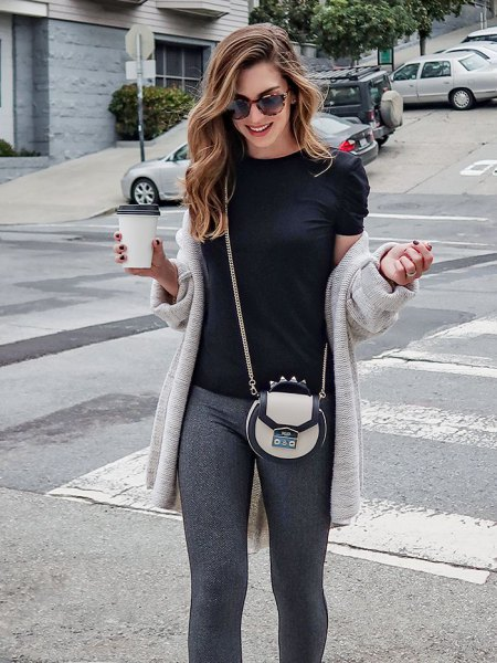 light gray longline cardigan with black t-shirt and knitted trousers