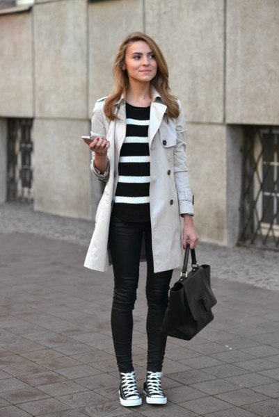 light gray long-linen coat with a black and white striped tunic sweater and jeans
