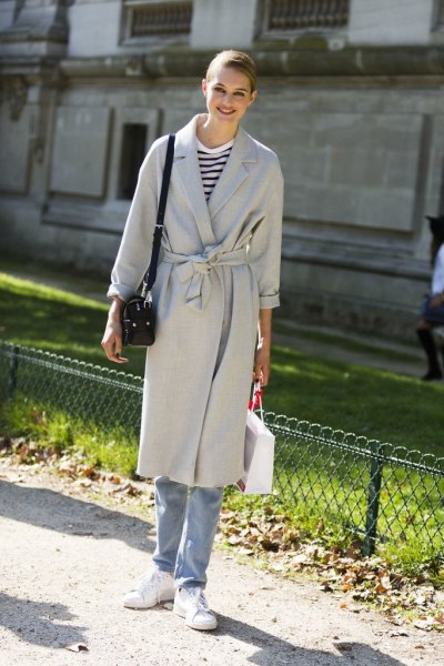 Light gray midi coat with belt and blue boyfriend jeans