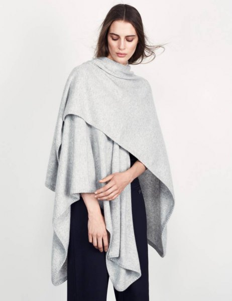 light gray poncho all black outfit