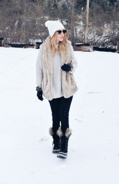 light gray, ribbed, chunky sweater dress with black faux fur snowshoes