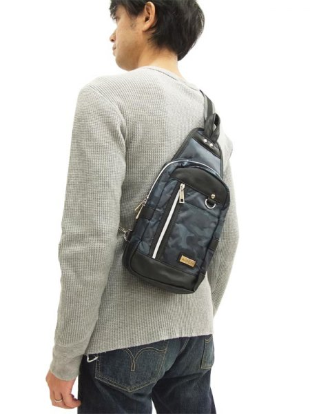 light gray ribbed sweater with a camouflage pouch