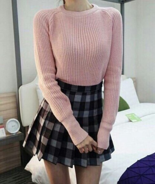 Light gray ribbed sweater with a checked mini pleated skirt