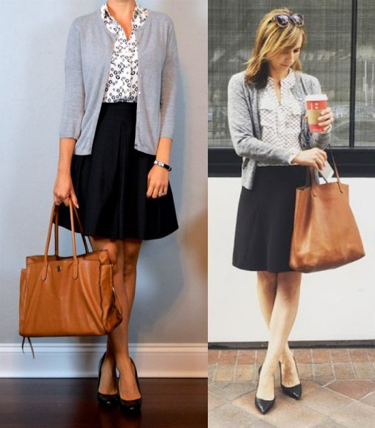light gray short cardigan with white printed shirt and black, flared knee-length skirt