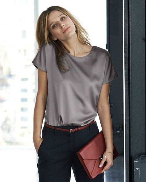 light gray short-sleeved silk top with black chinos