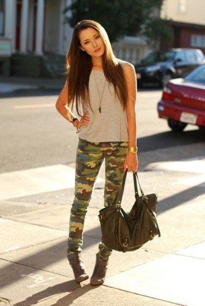 Light gray sleeveless top with camo jeans and ankle boots