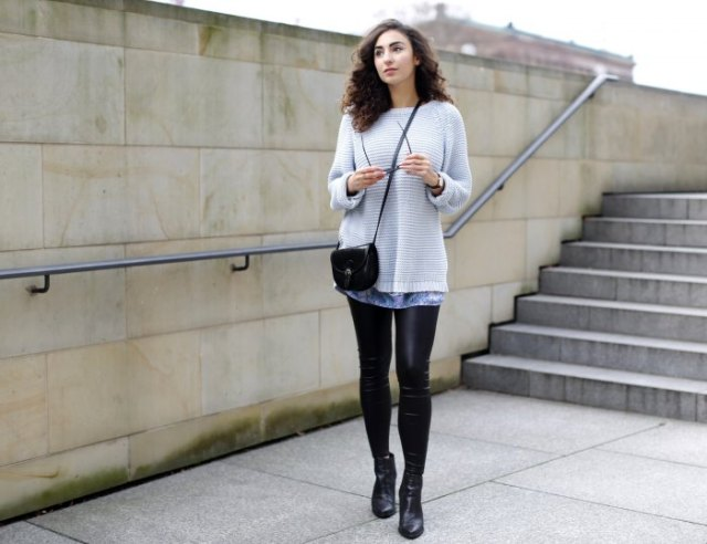 Light gray sweater over tie-dye tunic top and leather gaiters