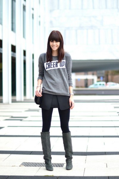 Light gray sweater with black wrap skirt and over-the-knee suede boots
