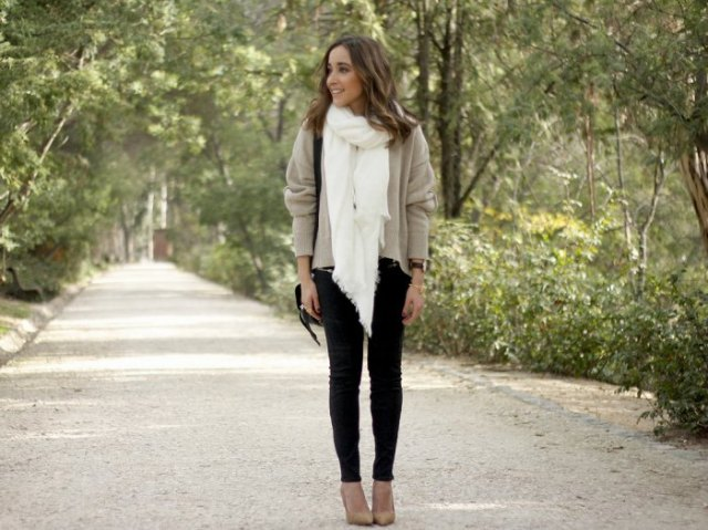 light gray sweater with white scarf and black skinny jeans