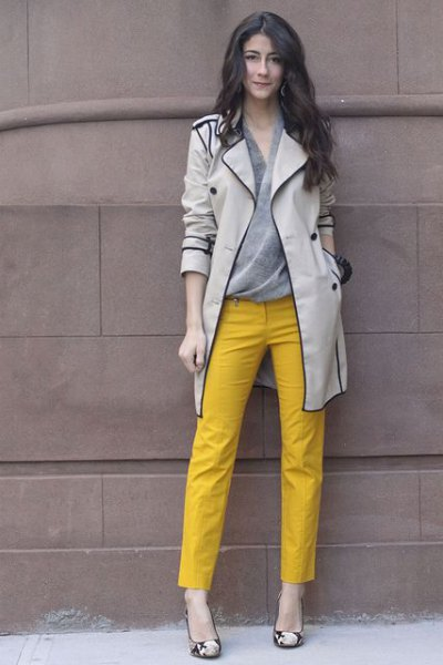 light gray trench coat with yellow ankle pants