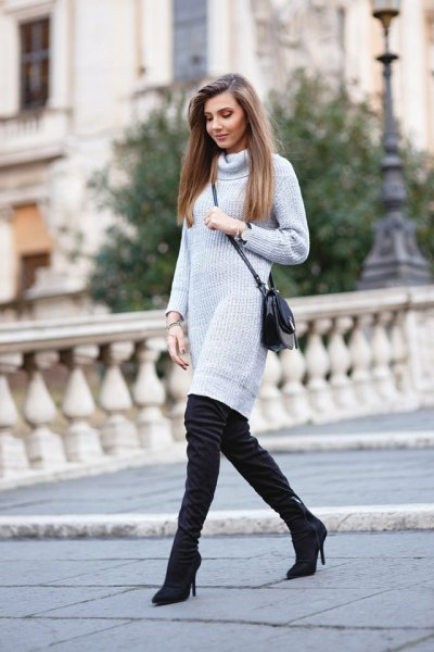light gray turtleneck dress with turtleneck and black, high-heeled boots