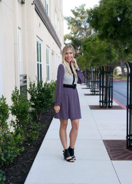 light gray vest with a long-sleeved mini dress and open toe boots
