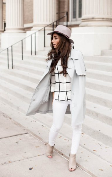 Light gray walker coat with a checked top and white jeans