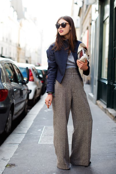 light gray tweed trousers with wide legs, black moto jacket