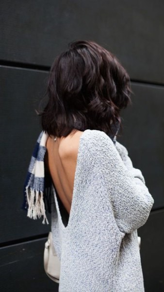 light mottled gray sweater with checked scarf