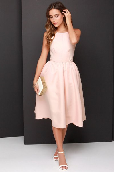 Light, peach-colored fit and flared sleeveless long dress