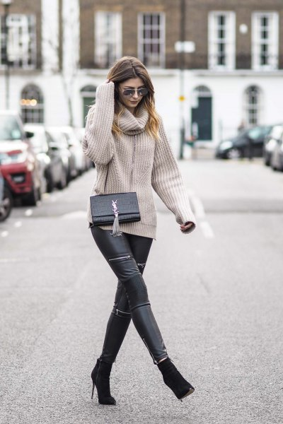 Light pink ribbed sweater with a cowl neckline and black biker pants