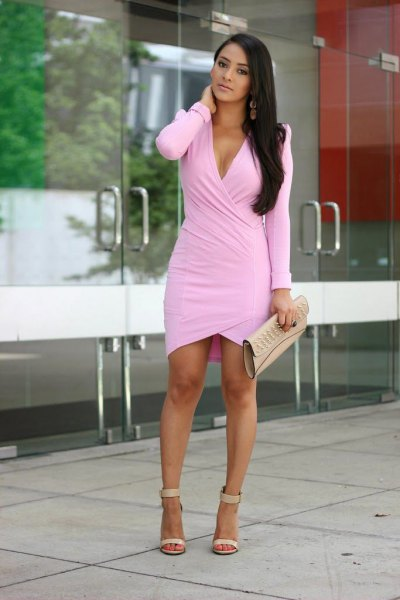 Light pink long-sleeved wrap dress with leather clutch