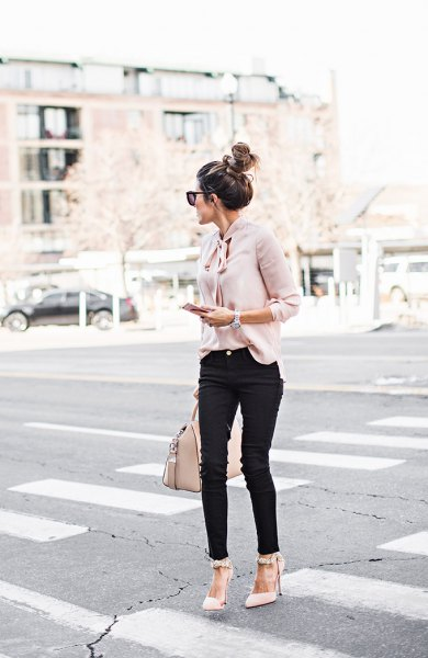 light pink band blouse with black jeans and pointed toe heels