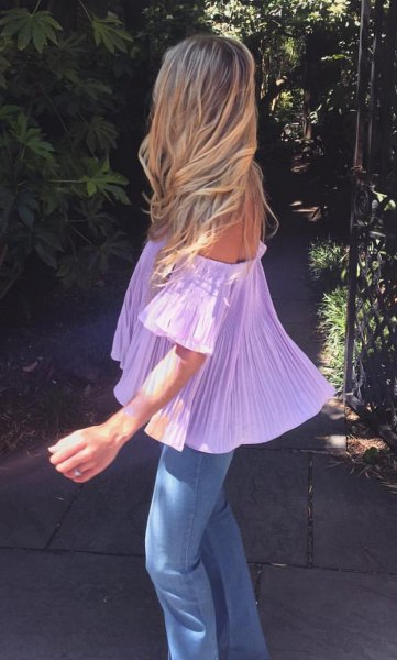 light purple off-shoulder pleated blouse with skinny jeans