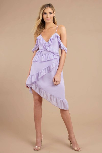 Light purple, asymmetrical slip dress with ruffles and pink heels